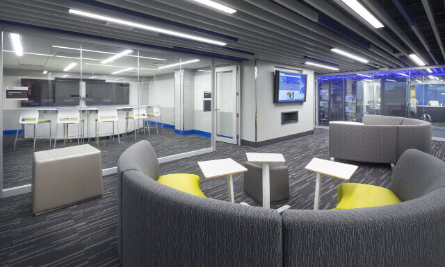 Central Community College ITS Classroom Break Out Lounge Area with Mounted TV, Contemporary Furniture, and Glass Walls