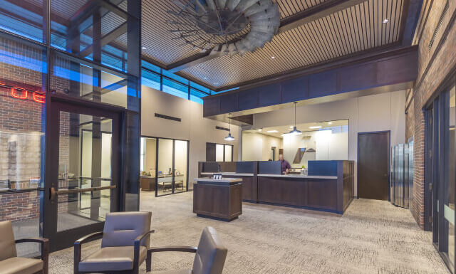 Front Lobby of a Bank with Rustic Decor and An Overall Warm Vibe